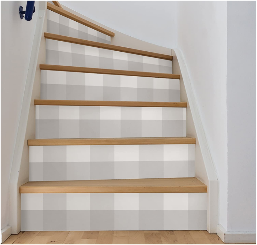 Gingham gray peel and stick wallpaper on stair risers.